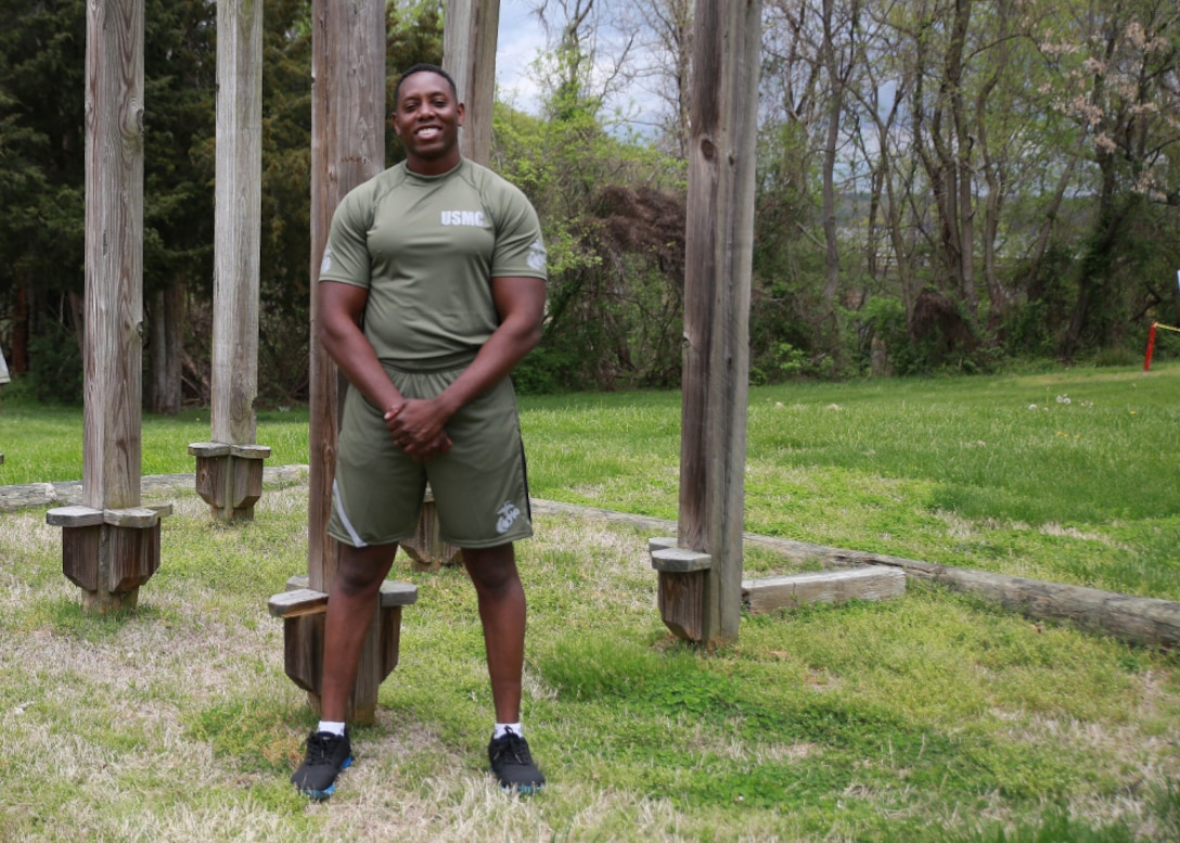 Capt. Donovan Holloway, an intelligence officer at Marine Corps Systems Command, demonstrates a prototype version of the new Physical Training Uniform, April 13.