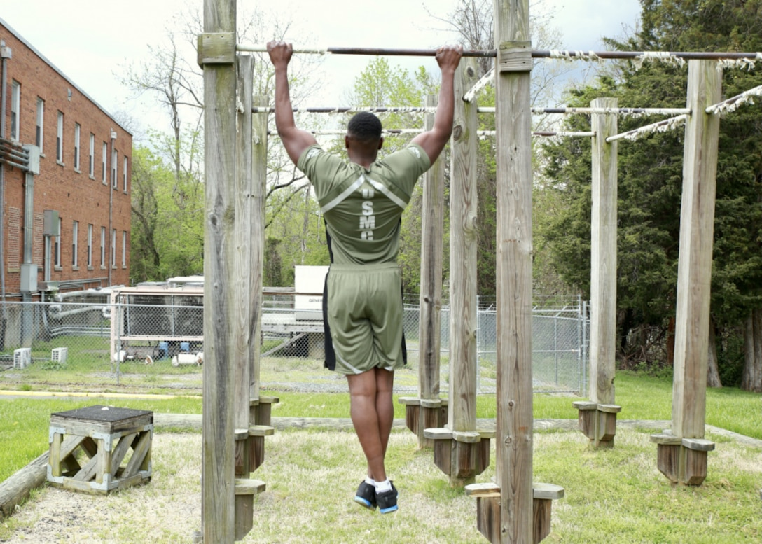 Capt. Donovan Holloway, demonstrates a prototype version of the new Physical Training Uniform, April 13.