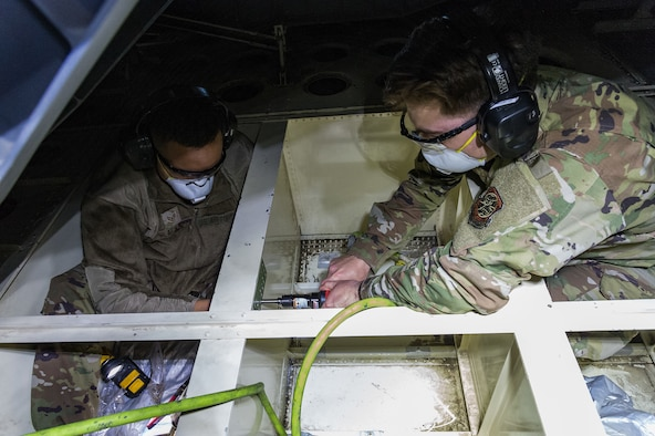 Staff Sgt. Konner Blackwell and Senior Airman Jack Ventrella, both 436th Maintenance Squadron aircraft structural maintenance journeymen, make repairs on a C-17 Globemaster III on Dover Air Force Base, Delaware, April 7, 2021. Blackwell and Ventrella repaired a crack on the ramp number 2 bulkhead. (U.S. Air Force photo by Roland Balik)