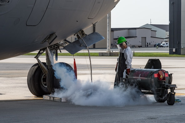 Senior Airman Anthony Enriquez, 736th Aircraft Maintenance Squadron crew chief, services a C-17 Globemaster III with liquid oxygen on Dover Air Force Base, Delaware, April 7, 2021. The C-17 is capable of rapid strategic delivery of troops and all types of cargo to main operating bases or directly to forward bases around the world. Thirteen C-17s are assigned to Dover AFB. (U.S. Air Force photo by Roland Balik)