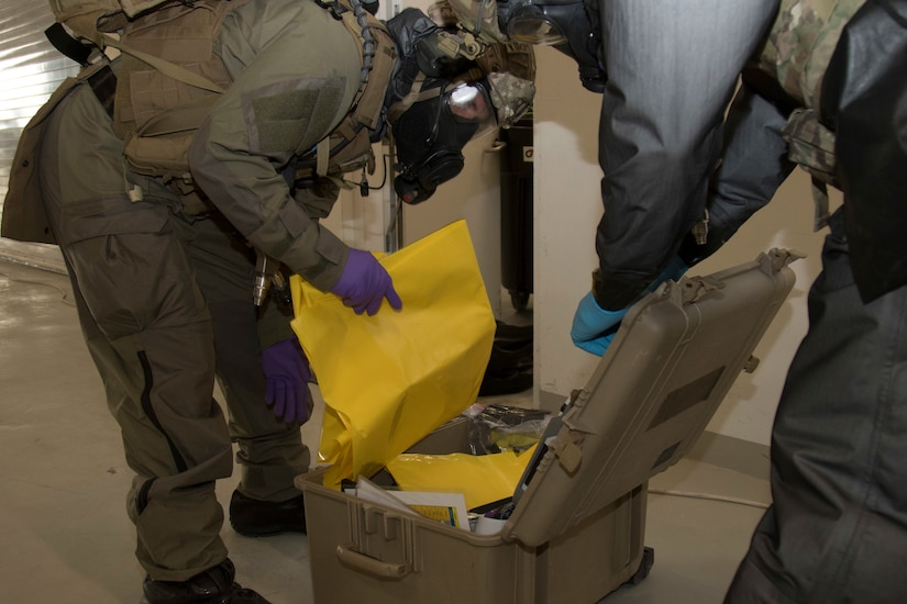 U.S. Special Operations Forces pull out chemical detection equipment to test for hazardous materials in a simulated scenario during exercise Invincible Sentry, March 23, 2021, near Doha, Qatar. U.S. Central Command's annual bilateral exercise allows the U.S. and Qatar to work together toward prevailing against complex regional security challenges. (U.S. Army photo by Staff Sgt. Daryl Bradford, Task Force Spartan Public Affairs)