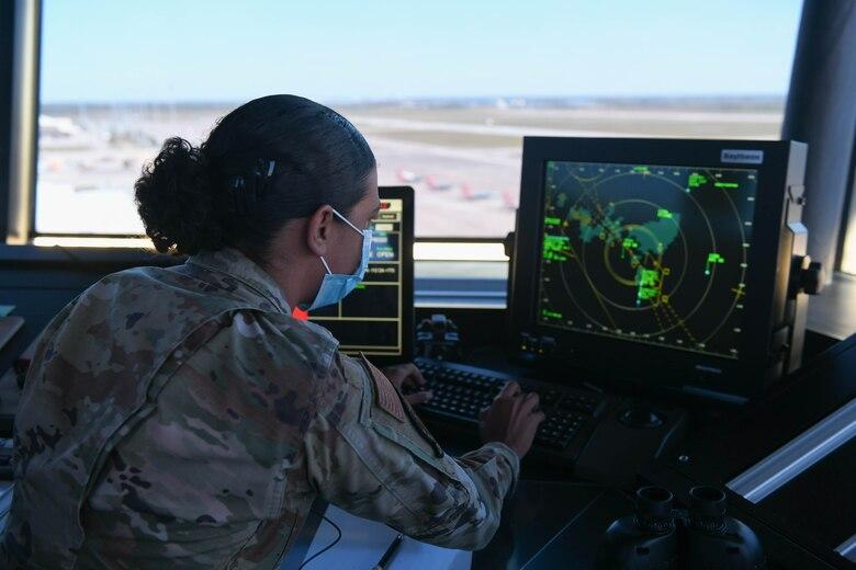 An Airman looks at a radar.