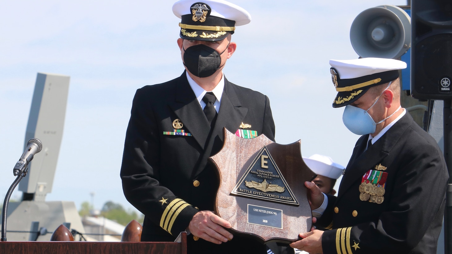 PORTSMOUTH, Va. (April 9, 2021) – Cmdr. Donald J. Curran III, left, and Cmdr. Sam T. Sareini, right, are presented with the Battle Effectiveness Award during the Arleigh Burke-class guided-missile destroyer USS Nitze's change of command ceremony. Sareini was relieved by Curran during the ceremony. (U.S. Navy photo by Ens. William Fong/Released)