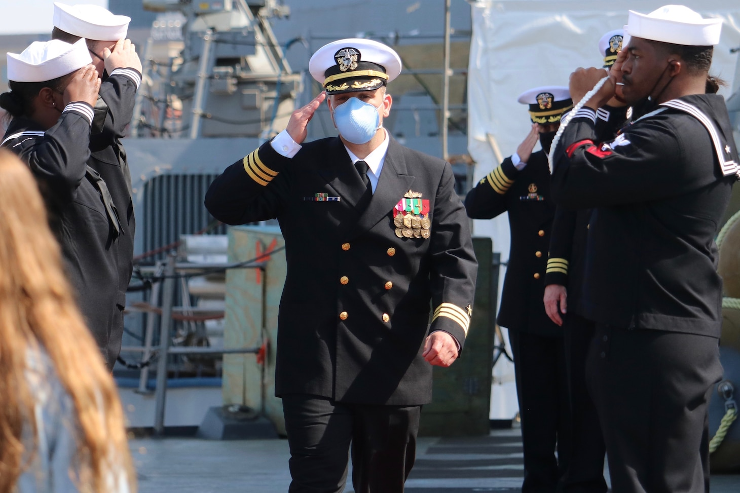 PORTSMOUTH, Va. (April 9, 2021) – Cmdr. Sam T. Sareini is piped aboard before the Arleigh Burke-class guided-missile destroyer USS Nitze's change of command ceremony. Sareini was relieved by Cmdr. Donald J. Curran III during the ceremony. (U.S. Navy photo by Ens. William Fong/Released)