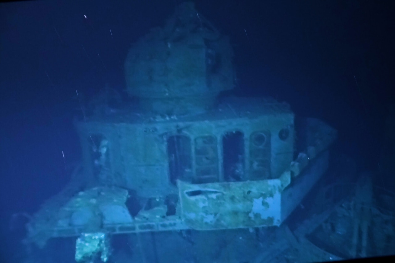 An underwater photo shows the wreckage of a ship that sank 75 years ago.