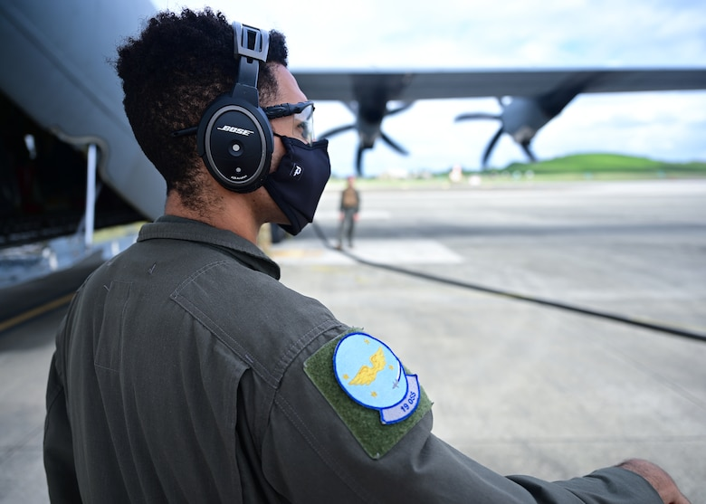 An Airman watches as a wet-wing defuel is performed on an aircraft.