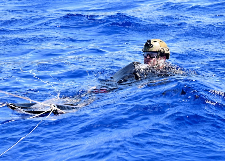 A Navy SEAL and his parachute land in the water