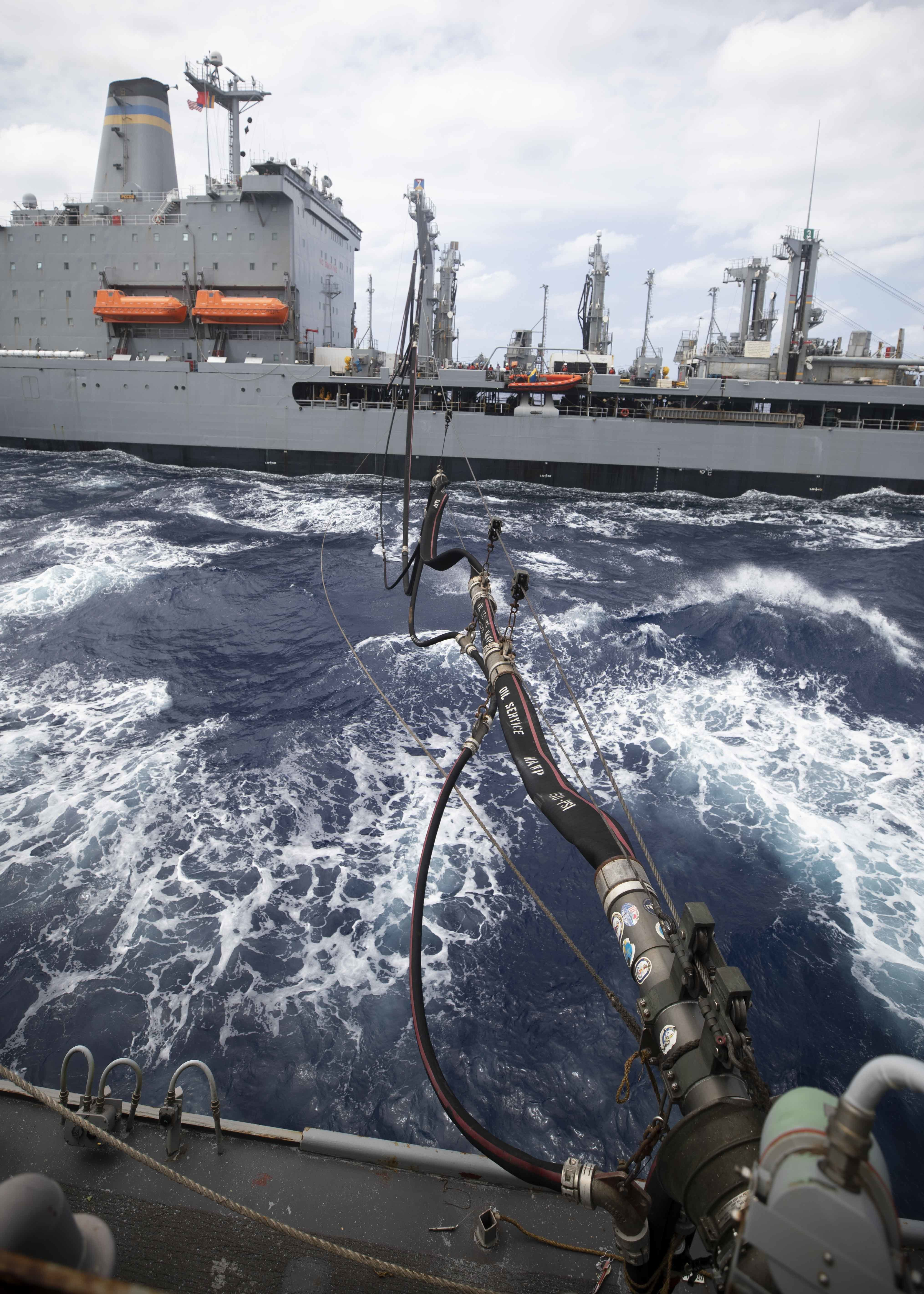 The Arleigh Burke-class guided-missile destroyer USS Rafael Peralta (DDG 115) conducts a refueling at sea with the fleet replenishment oiler USNS Pecos (T-AO 197).