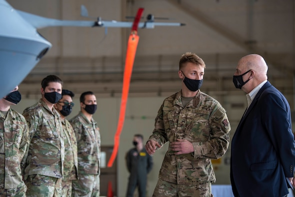 Acting Secretary of the Air Force John Roth, is briefed by a 432nd Maintenance Group Airman on the capabilities of the MQ-9 Reaper before meeting superior performers at Creech Air Force Base, Nev., March 25, 2021. Roth recognized Airmen from across the Wing, who are a testament to the array of specialties and talents needed to keep the U.S. ahead of the enemy. (U.S. Air Force photo by Senior Airman Haley Stevens)