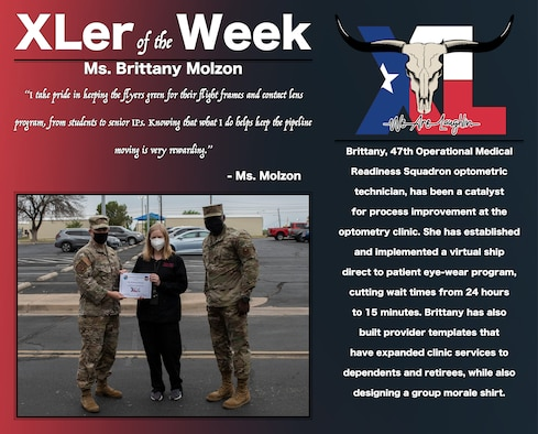 """Brittany Molzon, 47th Maintenance Directorate power support systems work leader, was chosen by wing leadership to be the """"XLer of the Week"""", the week of Apr. 16, 2021, at Laughlin Air Force Base, Texas. The """"XLer"""" award, presented by Col. Craig Prather, 47th Flying Training Wing commander, and Chief Master Sgt. Brian Lewis, 47th Operations Group superintendent, is given to those who consistently make outstanding contributions to their unit and the Laughlin mission. (U.S. Air Force Graphic by Airman 1st Class David Phaff)"""