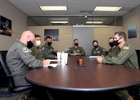 Sitting far right, Lt. Col. Seth Asay, 733rd Training Squadron commander, speaks with 4th Air Force A3 team members during their visit to the 433rd Airlift Wing, April 9, 2021, at Joint Base San Antonio-Lackland, Texas. The team learned about potential deficiencies in training with the goal to assist facilitation of improvements to 4th AF leadership. (U.S. Air Force photo by Tech. Sgt. Samantha Mathison)