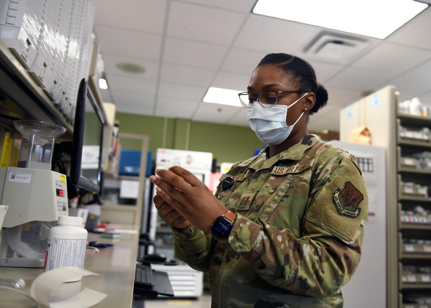 Service member labels a prescription pill vial