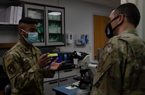 Airman talks to another Airman