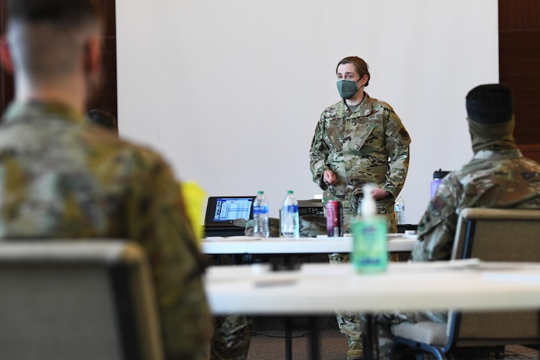 Col. Heather Fox, 9th Reconnaissance Wing Commander, center, talks to Airmen attending the Spiritual ISR(Intelligence Surveillance and Reconnaissance) Program, March 29, 2021, at Beale Air Force Base, California. The program is offered once every three months and is open to junior airmen who wish to create, discover, and enrich both aspects of their own lives and the lives of those they work with. (U.S. Air Force photo by Airman 1st Class Luis A. Ruiz-Vazquez)