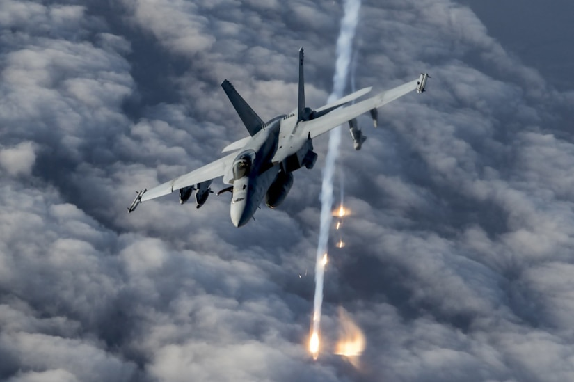A fighter plane releases flares over Afghanistan.