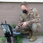 U.S. Air Force Senior Airman Shayne Mooney, an explosive ordinance disposal technician with the 902nd Civil Engineering Squadron at Joint Base San Antonio-Lackland, operates the Man Transportable Robotic Systems-Increment II, or MTSR II, during training at Joint Base San Antonio-Lackland April 14.