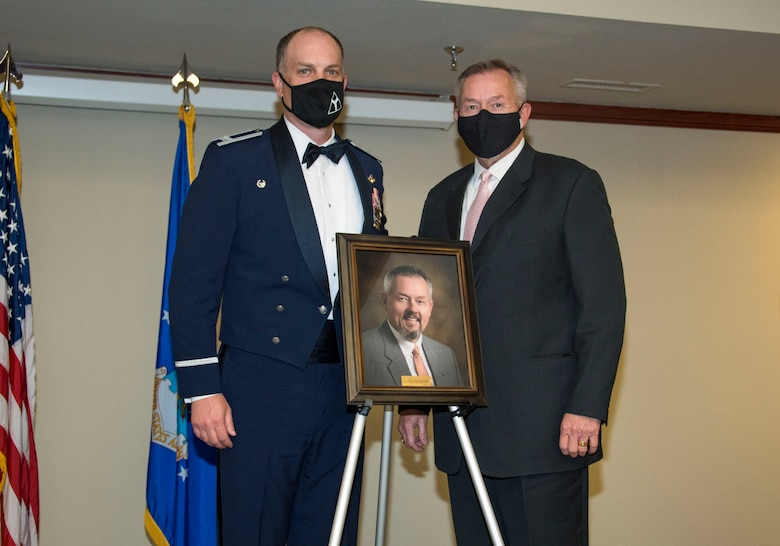 From left, Col. Matthew Leard, 97th Air Mobility Wing (AMW) commander, and Rodger Kerr, Altus Chamber of Commerce CEO and president, pose for a photo during a Friends of Altus induction ceremony on April 9, 2020, at Altus Air Force Base, Oklahoma. Kerr was one of two community leaders selected by Leard as a Friend of Altus, earning the highest honor a local civilian can receive from a 97th AMW commander. (U.S. Air Force photo by Airman 1st Class Amanda Lovelace)