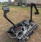 The Man Transportable Robotic System-Increment II, or MTSR II, navigates in a field during training at Joint Base San Antonio-Lackland April14.