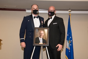 From left, Col. Matthew Leard, 97th Air Mobility Wing commander, and Brian Bush, Altus Air Force Base housing advocate, pose for a photo during a Friends of Altus induction ceremony on April 9, 2020, at Altus Air Force Base, Oklahoma. Bush was selected by Leard to become a Friend of Altus for his efforts in supporting the local community, Airmen and their families. (U.S. Air Force photo by Airman 1st Class Amanda Lovelace)