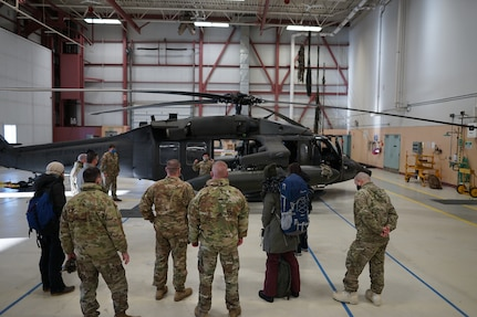 Members of the Alaska National Guard, along with members of the Alaska Department of Environmental Conservation, receive a passenger safety briefing prior to boarding an Army National Guard UH-60 Blackhawk for a flight from Bethel to Tuluksak, Alaska, April 8, 2021. Members of the Alaska Department of Military and Veterans Affairs, the Department of Environmental Conservation, and the Department of Commerce, Community, and Economic Development traveled to Western Alaska April 7-9 to meet with Tribal leaders and citizens in Bethel, Tuluksak, and Chevak to discuss disaster assistance measures and processes in light of recent emergencies that have occurred in the region, and in preparation for the upcoming flood season. (U.S. Army National Guard photo by Dana Rosso)
