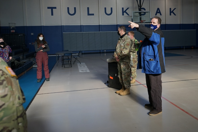 Members of the Alaska National Guard, along with members of the Alaska Department of Environmental Conservation, are introduced to the Tuluksak Tribal Council by Douglas Bushey, Principal of the Tuluksak School, Yupiit School District in Tuluksak, Alaska, April 8, 2021. Members of the Alaska Department of Military and Veterans Affairs, the Department of Environmental Conservation, and the Department of Commerce, Community, and Economic Development traveled to Western Alaska April 7-9 to meet with Tribal leaders and citizens in Bethel, Tuluksak, and Chevak to discuss disaster assistance measures and processes in light of recent emergencies that have occurred in the region, and in preparation for the upcoming flood season. (U.S. Army National Guard photo by Dana Rosso)