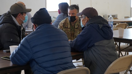 Maj. Gen. Torrence Saxe, commissioner for the Department of Military and Veterans Affairs and adjutant general of the Alaska National Guard, speaks with Chevak community members prior to a townhall meeting held at the Chevak City Office in Chevak, Alaska, April 9, 2021. Members of the Alaska Department of Military and Veterans Affairs, the Department of Environmental Conservation, and the Department of Commerce, Community, and Economic Development traveled to Western Alaska April 7-9 to meet with Tribal leaders and citizens in Bethel, Tuluksak, and Chevak to discuss disaster assistance measures and processes in light of recent emergencies that have occurred in the region, and in preparation for the upcoming flood season. (U.S. Army National Guard photo by Dana Rosso)