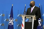 Secretary of Defense Lloyd J. Austin III speaks during a NATO news conference announcing an alliance military withdrawal from Afghanistan.
