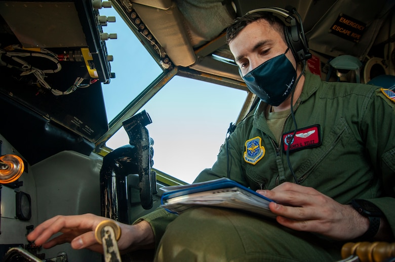 U.S. Air Force 1st Lt. Andres G. Velez, a 50th Air Refueling Squadron (ARS) pilot, reads the long format checklist binder while performing a preflight check on a KC-135 Stratotanker aircraft, at MacDill Air Force Base, Fla., April 9, 2021 prior to a 91st ARS deployment.  Airmen from the 50th ARS completed pre-deployment measures for deploying 91st ARS Airmen to help reduce the burden of certain preparations before the 91st flew to their deployed location. (U.S. Air Force photo by Airman 1st Class David D. McLoney)