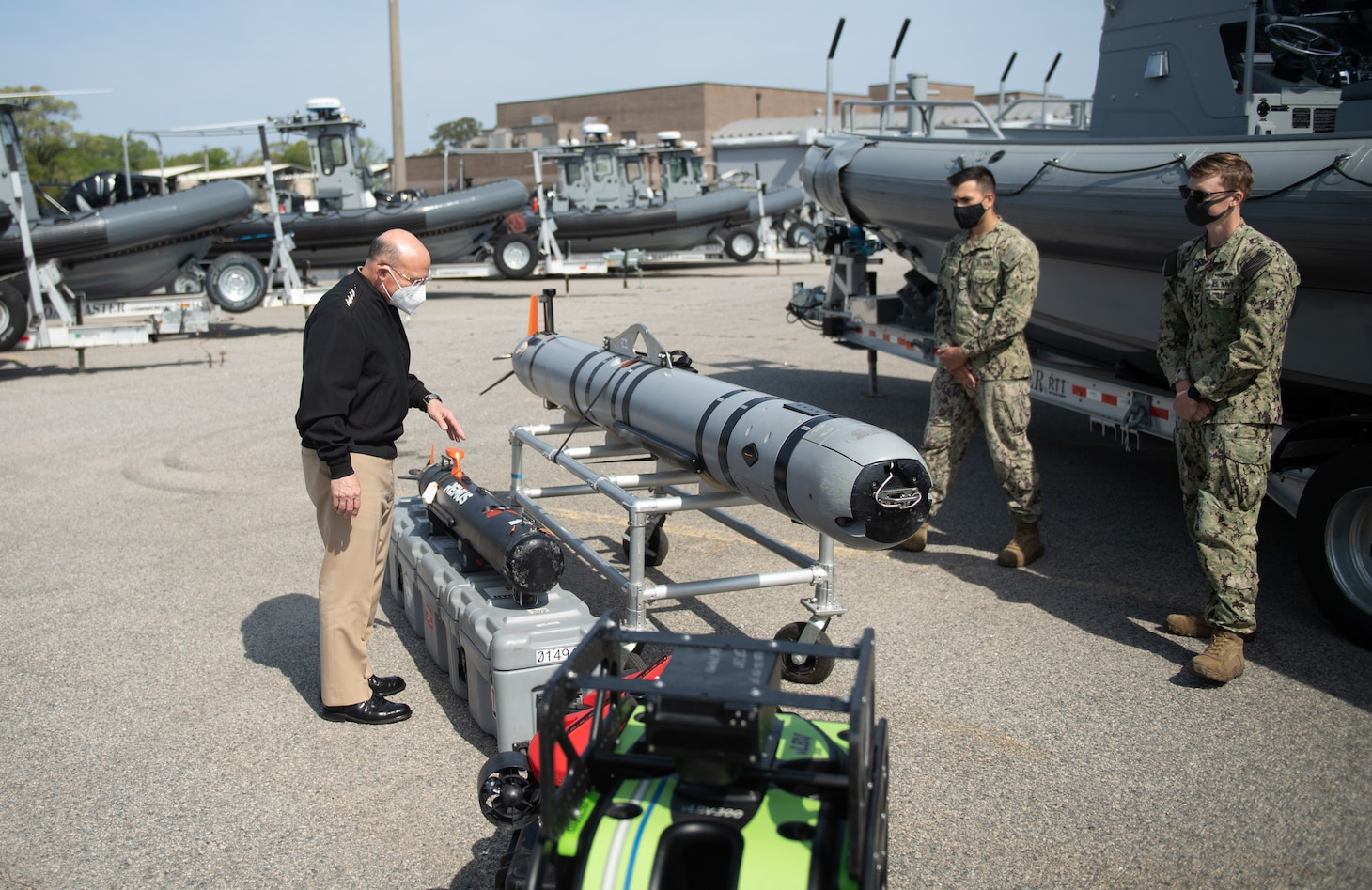 VIRGINIA BEACH, Va. (April 14, 2020) – Chief of Naval Operations Mike Gilday views a MK 18 MOD 2 unmanned undersea vehicle during a tour of Explosive Ordnance Disposal Group (EODGRU) Two STRIKE facility onboard Joint Expeditionary Base Little Creek, April 14, 2021. Gilday and Master Chief Petty Officer of the Navy Russel Smith toured the EODGRU 2 STRIKE facility and met with EOD operators and Navy divers to discuss capabilities and equipment employed by the force. EOD STRIKE protects individuals and teams in the EOD Force from debilitating stress through adaptability, recovery and growth across the personal, social, cognitive and physical wellness domains. (U.S. Navy photo by Mass Communication Specialist Seaman Apprentice Nicholas Skyles)