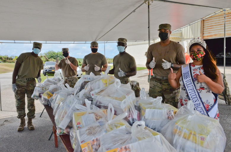 U.S. Air Force Airmen assigned to the 36th Civil Engineering Squadron and Kylani Ogo, Miss Voluptuous Pacific and Yona resident, participate a COVID-19 relief food distribution event at the community gym in Yona, Guam, April 15, 2021. The 36th CES is Yona's sister squadron, as part of the Andersen Air Force Base Sister Village Sister Squadron program, through which squadron members collaborate with Guam residents in activities to strengthen their friendship and partnership. (U.S. Air Force photo by Alana Chargualaf)