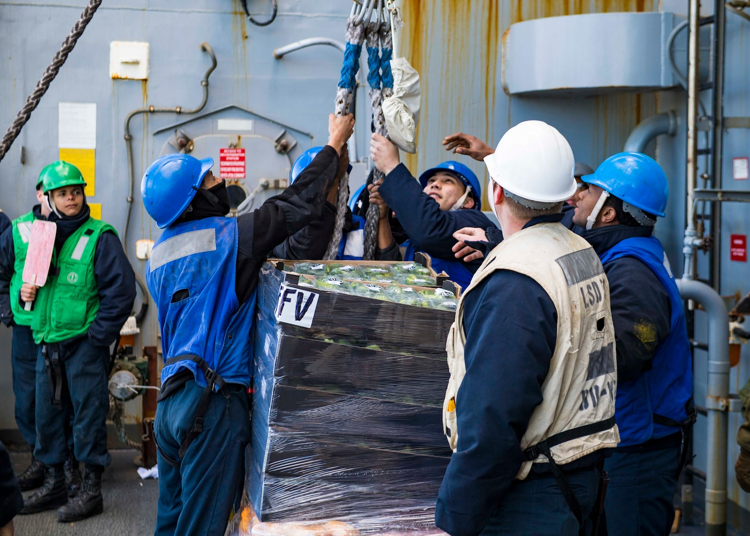 Sailors assigned to the Harpers Ferry-class dock landing ship USS Carter Hall (LSD 50) receive supplies from the fast combat support ship USNS Supply (T-AOE 6) during a replenishment-at-sea, April 12, 2021.