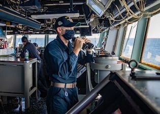 Ensign Dennis Didechkin stands watch aboard USS Barry (DDG 52).
