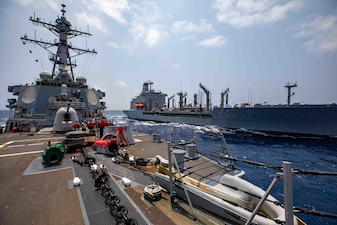 USS Barry (DDG 52) replenishes from USNS Pecos (T-AO 197).