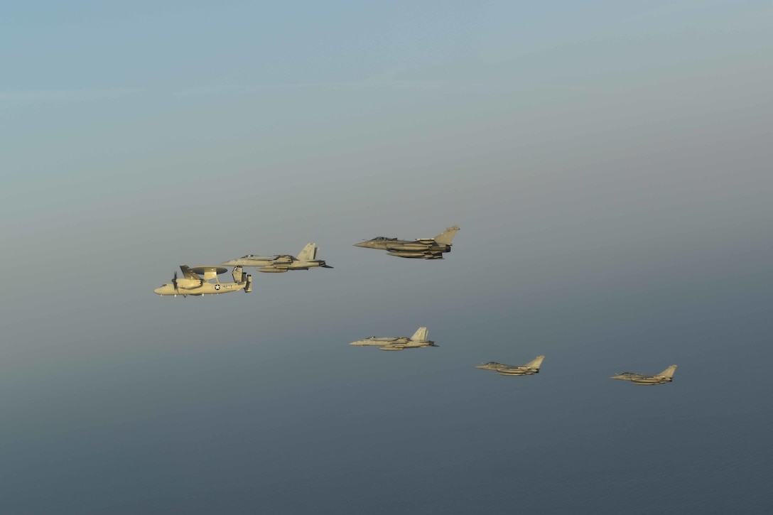 210413-N-NO712-1238 ARABIAN SEA (April 13, 2021) - U.S. Navy F/A-18F and F/A-18E Super Hornet fighter jets, an E-2C Hawkeye tactical airborne early warning aircraft and French Marine Nationale Dassault Rafale fighter jets fly in formation during dual carrier operations between the aircraft carriers USS Dwight D. Eisenhower (CVN 69) and FS Charles de Gaulle (R 91) in the Arabian Sea, April 13. The Eisenhower Carrier Strike Group is deployed to the U.S. 5th Fleet area of operations in support of naval operations to ensure maritime stability and security in the Central Region, connecting the Mediterranean and Pacific through the western Indian Ocean and three strategic choke points. (U.S. Navy Photo)