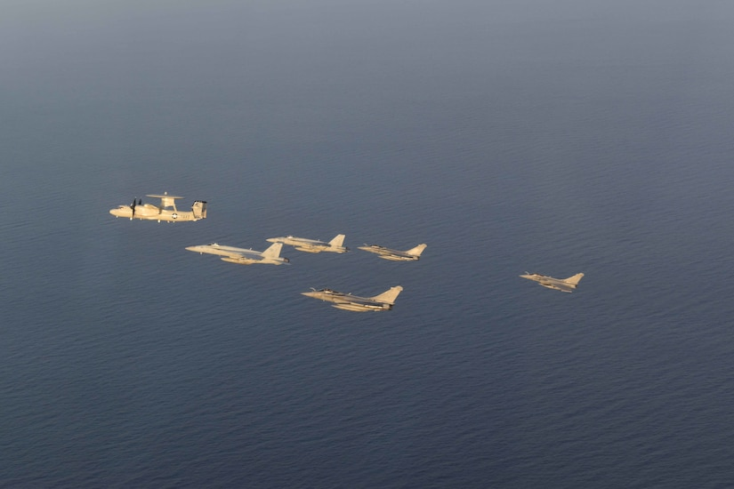 210413-N-NO712-1235 ARABIAN SEA (April 13, 2021) - U.S. Navy F/A-18F and F/A-18E Super Hornet fighter jets, an E-2C Hawkeye tactical airborne early warning aircraft and French Marine Nationale Dassault Rafale fighter jets fly in formation during dual carrier operations between the aircraft carriers USS Dwight D. Eisenhower (CVN 69) and FS Charles de Gaulle (R 91) in the Arabian Sea, April 13. The Eisenhower Carrier Strike Group is deployed to the U.S. 5th Fleet area of operations in support of naval operations to ensure maritime stability and security in the Central Region, connecting the Mediterranean and Pacific through the western Indian Ocean and three strategic choke points. (U.S. Navy Photo)
