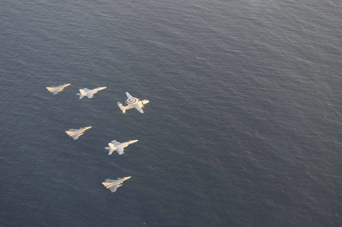 210413-N-NO712-1188 ARABIAN SEA (April 13, 2021) - U.S. Navy F/A-18F and F/A-18E Super Hornet fighter jets, an E-2C Hawkeye tactical airborne early warning aircraft and French Marine Nationale Dassault Rafale fighter jets fly in formation during dual carrier operations between the aircraft carriers USS Dwight D. Eisenhower (CVN 69) and FS Charles de Gaulle (R 91) in the Arabian Sea, April 13. The Eisenhower Carrier Strike Group is deployed to the U.S. 5th Fleet area of operations in support of naval operations to ensure maritime stability and security in the Central Region, connecting the Mediterranean and Pacific through the western Indian Ocean and three strategic choke points. (U.S. Navy Photo)