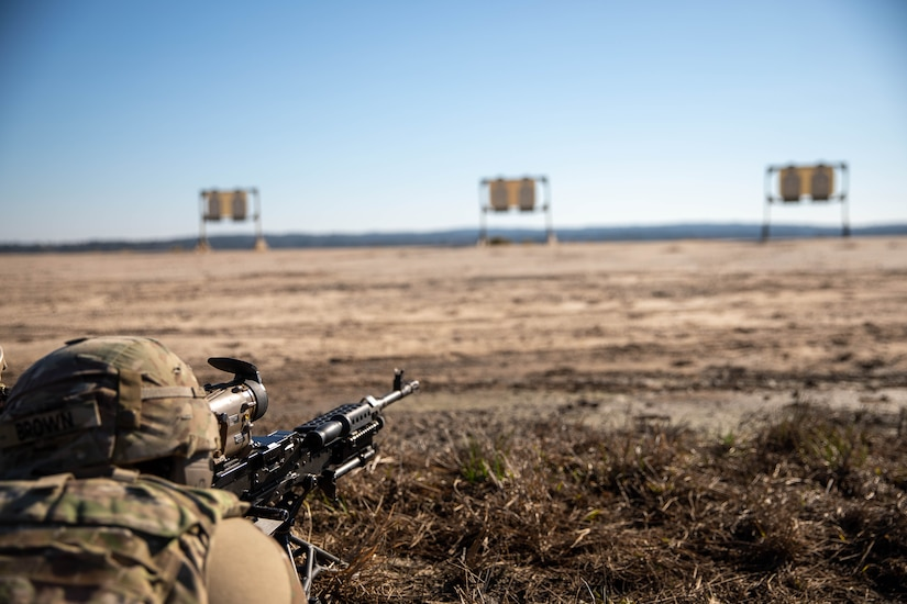 Soldier with 2-325, 82nd Airborne Division zeroing the Family of Weapons Sight – Crew Served to the M-249 Medium Machine Gun during a Soldier Touchpoint in Fort Benning, GA.