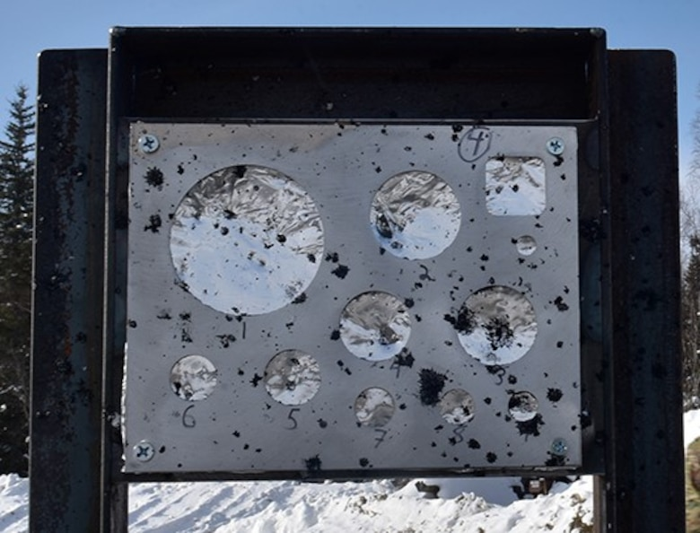A gauge stand measures the effect of an explosion during the snow mitigation test on March 18, 2021, at Eielson Air Force Base, Alaska. The foil pieces are used to measure the blast caused by the explosion. (U.S. Air Force photo/Senior Airman Danielle Sukhlall)