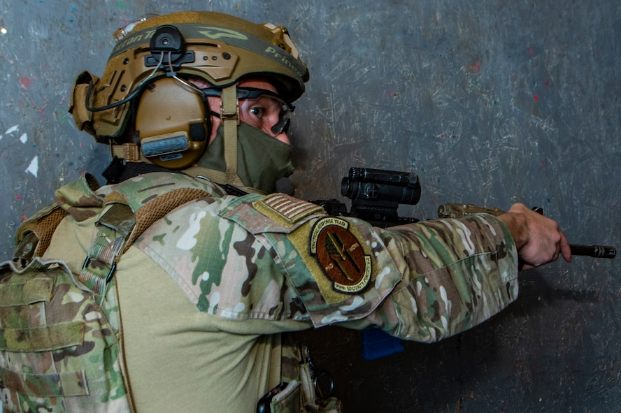 Airman points a rifle during training.