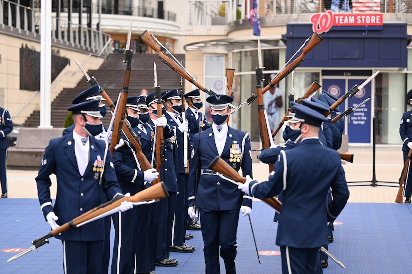 Members of the United States Air Force Honor Guard perform for the first time at National Harbor in Washington D.C. on March 25, 2021. 300 ceremonial guardsmen make up the official ceremonial unit of the United States Air Force,  serving a five-state area of responsibility and performing more than 3,000 missions per year. Missions involve honoring the President of the United States, Foreign Heads of State and senior Department of Defense and Air Force leaders; performing ceremonial guardsman duties for ceremonies for Presidential and Joint Service events; wreath-laying ceremonies at the Tomb of the Unknown and the Air Force Memorial; and carrying out military funeral honors at Arlington National Cemetery. (U.S. Air Force photo by Tech. Sgt. Darren Workman)