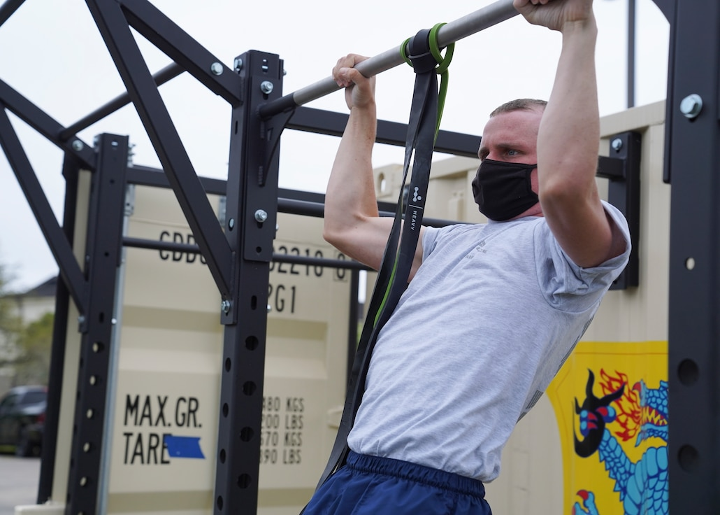 U.S. Air Force Airman Connor Jones, 336th Training Squadron cyber surety student, does a pull up on a Beaver Fit Box at Keesler Air Force Base, Mississippi, April 10, 2021. The 81st Training Group acquired the Beaver Fit Boxes to provide more places for Airmen in training to work out while indoor gyms are operating at a limited capacity. (U.S. Air Force photo by Senior Airman Spencer Tobler)