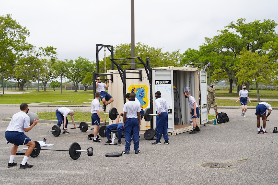 Airmen from the 336th Training Squadron exercise on a Beaver Fit Box at Keesler Air Force Base, Mississippi, April 10, 2021. The 81st Training Group acquired the Beaver Fit Boxes to provide more places for Airmen in training to work out while indoor gyms are operating at a limited capacity. (U.S. Air Force photo by Senior Airman Spencer Tobler)