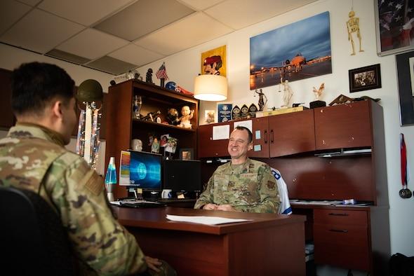 AF Reserve recruiter talks to an Airman.