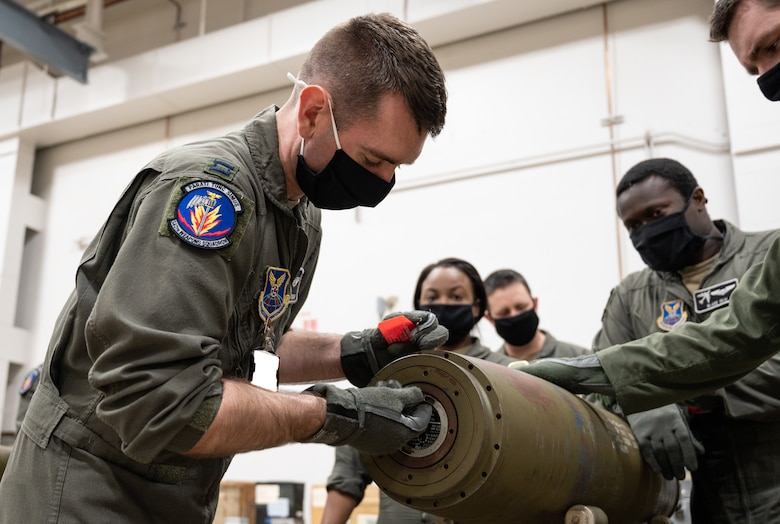 A student from the 340th Weapons Squadron weapons instructor training course inserts the fuse into an inert GBU-31 munition at Barksdale Air Force Base, April 13, 2021. The students learned how to safely assemble and maintain munitions used on the B-52H Stratofortress. (U.S. Air Force photo by Airman William Pugh)