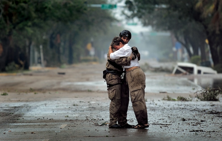 Pararescueman Staff Sgt. Lopaka Mounts receives a hug from a Texas resident Sept. 13 during search and rescue operations after Hurricane Ike. Sergeant Mounts is assigned to the 331st Air Expeditionary Group at Randolph Air Force Base, Texas. (U.S. Air Force photo/Staff Sgt. James L. Harper Jr.)