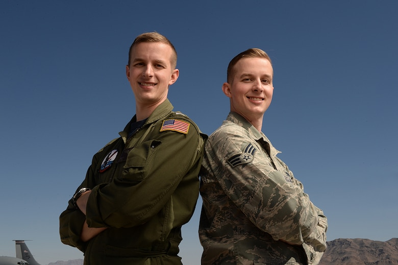 U.S. Navy LTJG Scott Russell and U.S. Air Force Senior Airman Brian Russell, reunite in uniform during Red Flag 15-2 at Nellis Air Force Base, Nevada, March 7, 2015. Brian is a KC-135 Stratotanker crew chief with the 22nd Maintenance Squadron at McConnell Air Force Base, Kansas, while Scott is a Navy Lieutenant junior grade and an EP-3E Aeries pilot with the Fleet Air Reconnaissance Squadron One at Naval Air Station Whidbey Island, Washington. (U.S. Air Force photo by/Staff Sgt. Vernon Young Jr.)