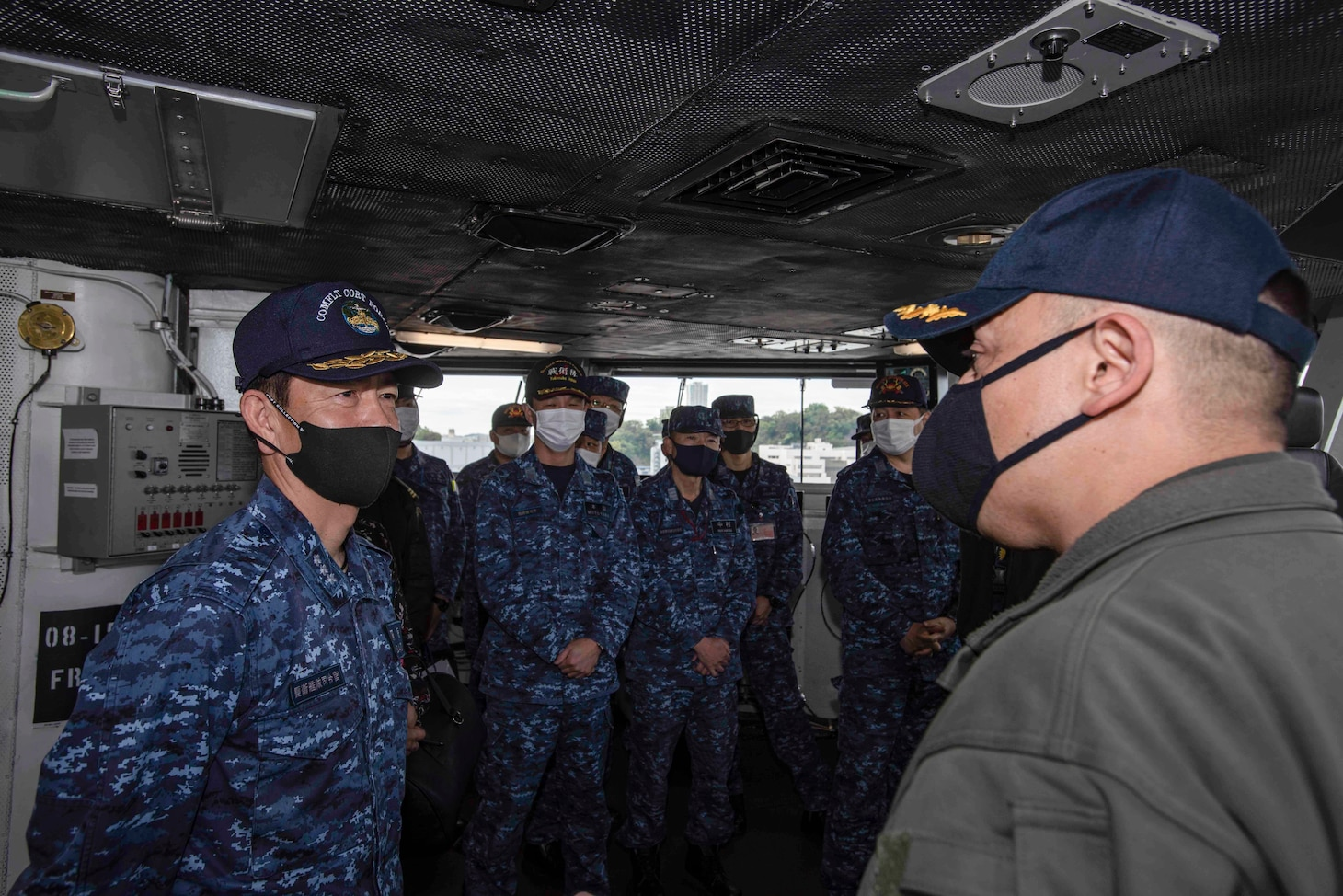 210415-N-WS494-1167 YOKOSUKA, Japan (April 15, 2021) Vice Adm. SAITO Akira, commander of Japan Maritime Self-Defense Force (JMSDF) Fleet Escort Force, receives a tour of the pilot house from Capt. Fred Goldhammer, commanding officer of the U.S. Navy's only forward deployed aircraft carrier USS Ronald Reagan (CVN 76). Leadership from the 7th Fleet task forces that command Carrier Strike Group (CSG) 5 and Task Force 71 met with the commander of JMSDF Fleet Escort Force aboard Ronald Reagan for a ship tour and staff discussions. Ronald Reagan, the flagship of CSG 5, provides a combat-ready force that protects and defends the United States, as well as the collective maritime interests of its allies and partners in the Indo-Pacific region. (U.S. Navy Photo by Mass Communication Specialist 3rd Class Quinton A. Lee)
