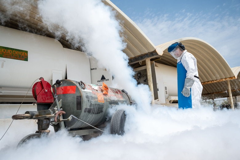 Senior Airman Steven C. Rehana purges a liquid oxygen cart.