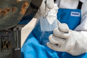 Senior Airman Steven C. Rehana collects a liquid oxygen sample.