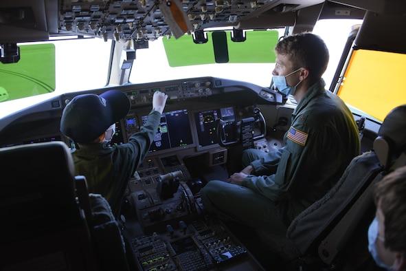 pilot explains controls to kid